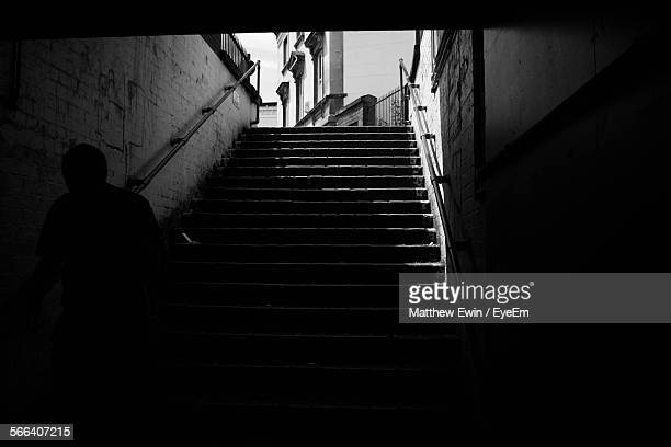 Silhouette Man Walking On Staircase In Basement