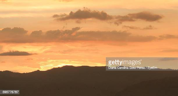 Silhouette Mountains Against Orange Cloudy Sky