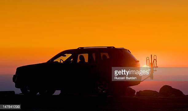 silhouette of 4 wheel drive vehicle at sunrise