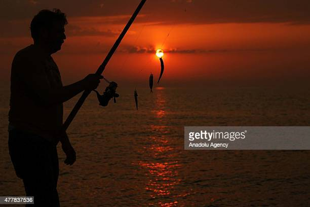 Silhouette of a amateur fisherman is seen during sunset in Abana district of Kastamonu a province in the Black Sea region of Turkey on May 26 2015