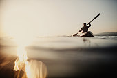 Silhouette of a canoeist