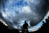 Silhouette of a chair umpire under darkening sky on day six of the Wimbledon Lawn Tennis Championships at the All England Lawn Tennis and Croquet...