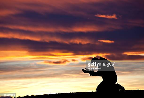 Silhouette of a Distraught Man Against a Sunset