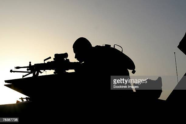 Silhouette of a gunner.
