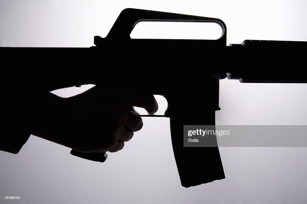 Silhouette of a hand holding a gun
