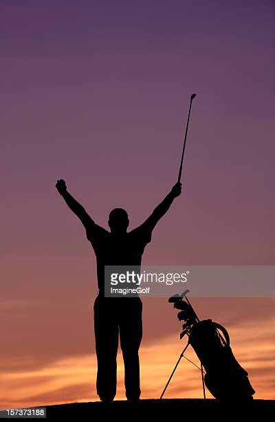 Silhouette of a Happy Golfer at Sunset