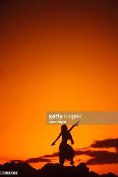 Silhouette of a Hawaiian hula dancer dancing on the beach, Hawaii, USA