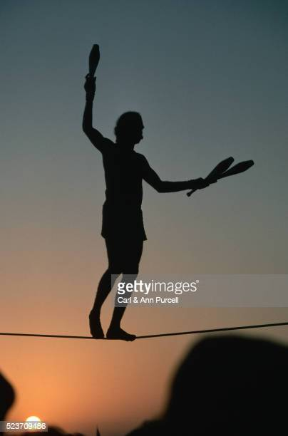 Silhouette of a Juggler on a Tight-Rope