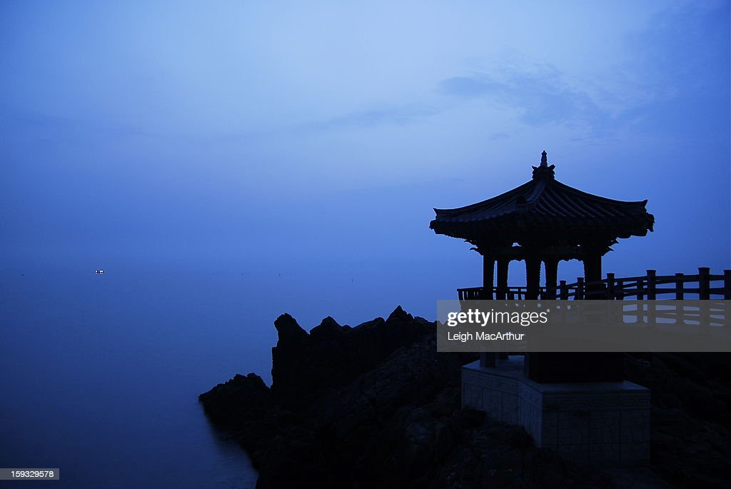 CONTENT] A silhouette of a Korean gazebo with a fishing boat with its lights are seen in the distance off the eastern coast of South Korea in a city named Samcheok as a low level fog starts to lift just before the sun rises on June 3rd, 2012.