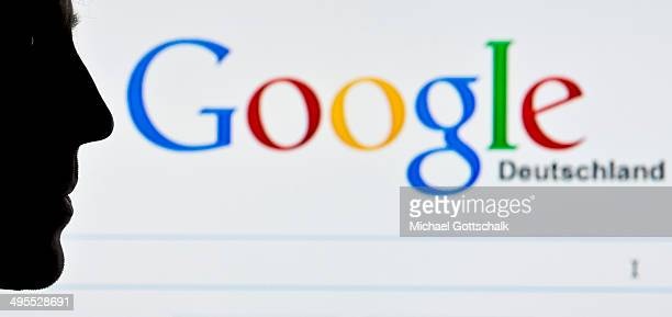 A silhouette of a man is seen in front of a screen on which the Google search engine is displayed on June 02 2014 in Berlin Germany