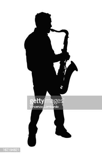 Silhouette of a man playing saxophone : Stock Photo
