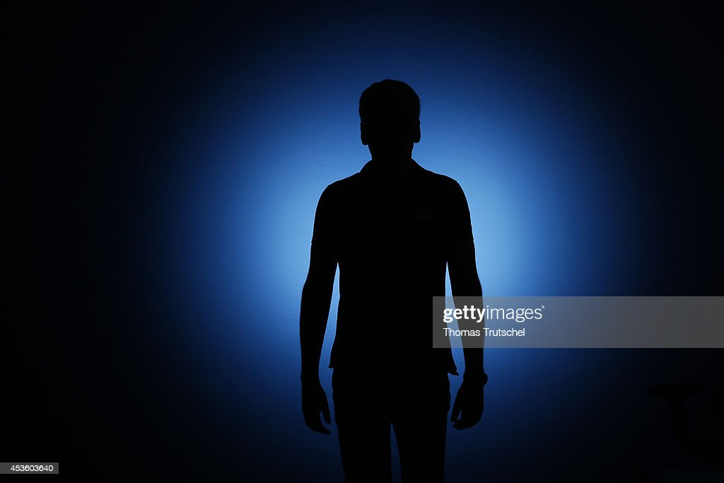 Silhouette of a man standing in front of a blue background on August 06 in Berlin Germany