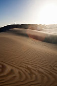 Silhouette of a man standing on a sand dune, Maitlands Beach, Port Elizabeth, Eastern Cape, South Africa