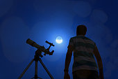 Silhouette of a man with telescope, Moon and stars. My astronomy work.