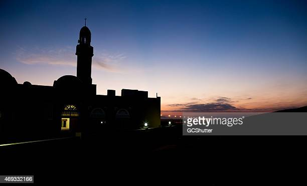 Silhouette of a Mosque at Sunrise in Hatta Desert, Dubai