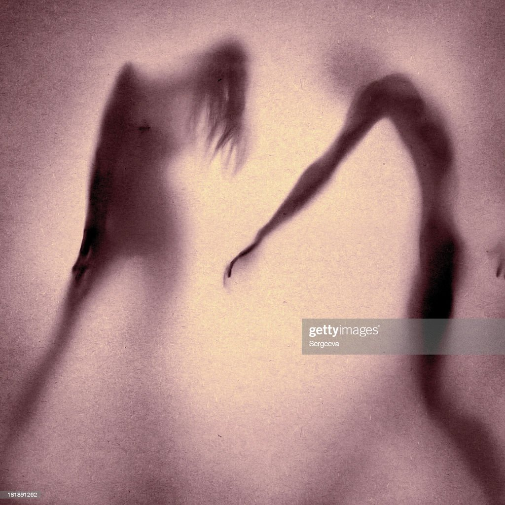silhouette of a nude couple : Stock Photo