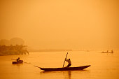 Silhouette of a person rowing a boat, Dal Lake,
