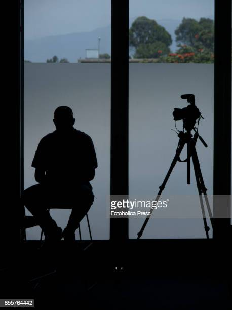 Silhouette of a photojournalist and his camera taking a break between sessions of the United Nations Framework Conference on Climate Change UNFCCC...