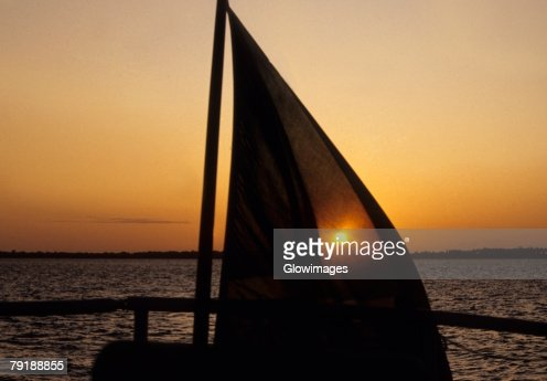 Silhouette of a sailboat in the sea at sunset, Pemba, Tanzania : Stock Photo