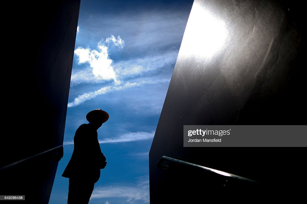 Silhouette of a security guard at the entrance to court court 2 during day one of the Wimbledon Lawn Tennis Championships at the All England Lawn Tennis and Croquet Club on June 26, 2016 in London, England.