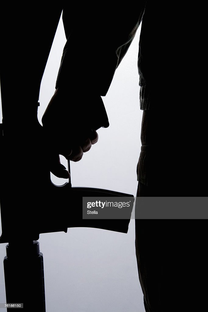 Silhouette of a soldier holding a gun