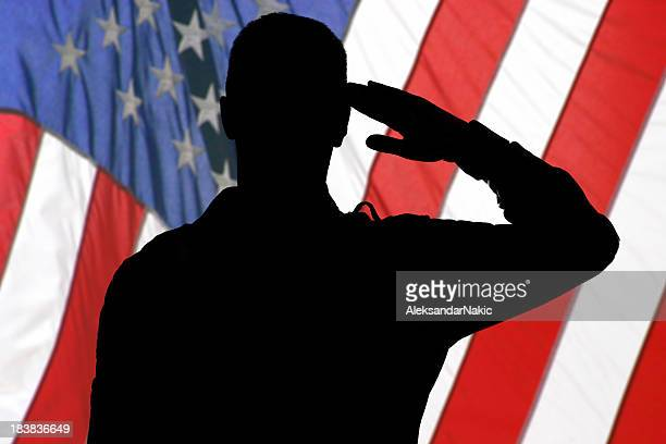 Silhouette of a soldier saluting to American flag