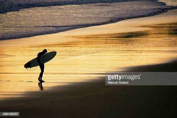 Silhouette of a surfista going out of the sea