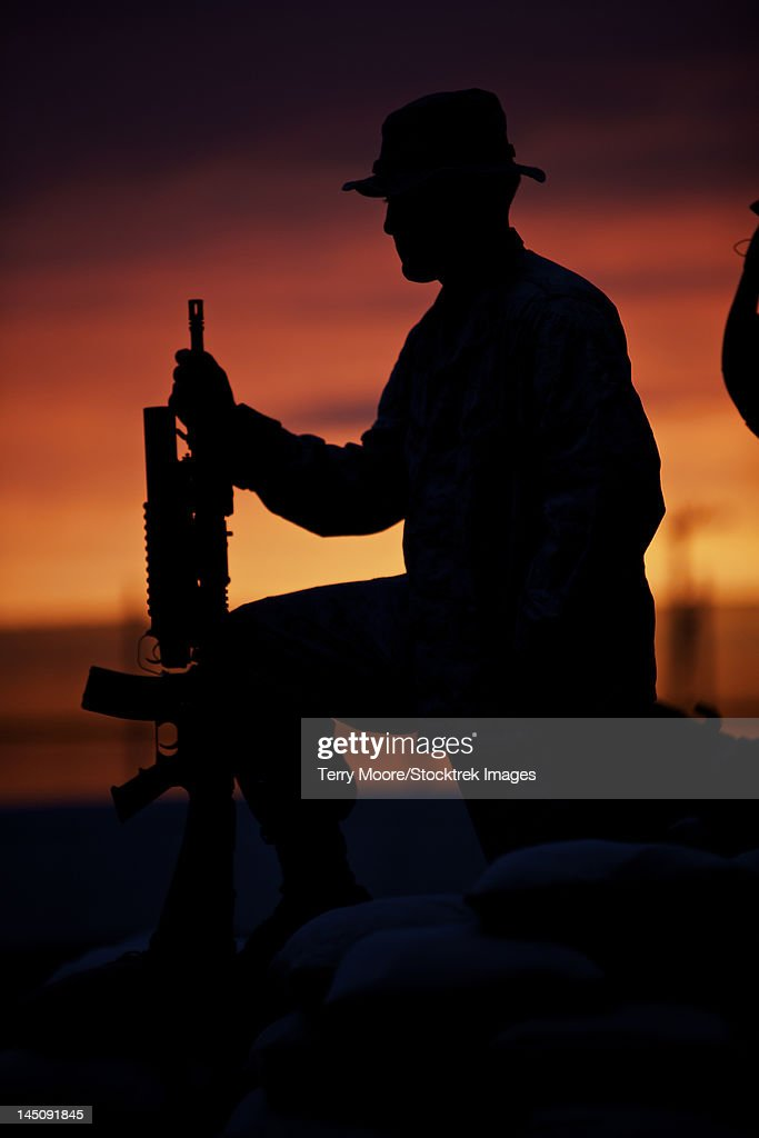 Silhouette of a U.S Marine on a bunker at sunset in Northern Afghanistan.
