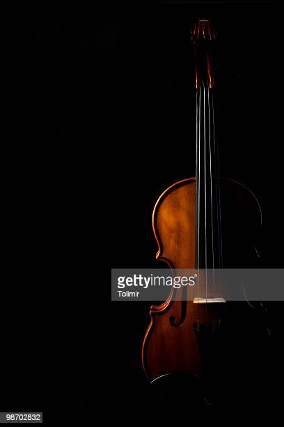 Silhouette of a violin on a black background