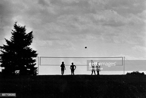 Silhouette of a Volleyball Game A foursome got together for a little volleyball game in Cheesman Park afternoon Denverites basked in upper80...