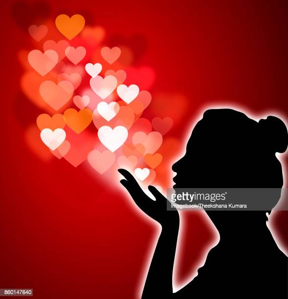 Silhouette of a woman sending love