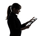 one business woman computer computing typing digital tablet  silhouette studio on white background