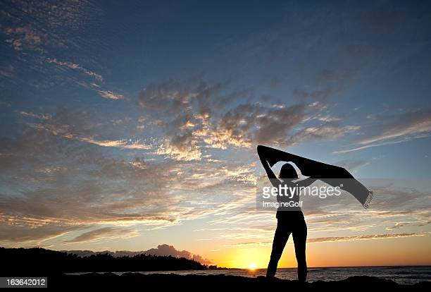 Silhouette of a Woman With Shawl at the Beach