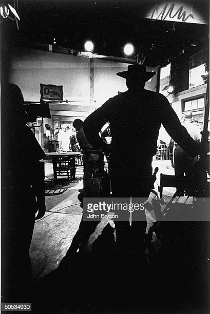Silhouette of actor James Arness on the Gunsmoke set at California Studios