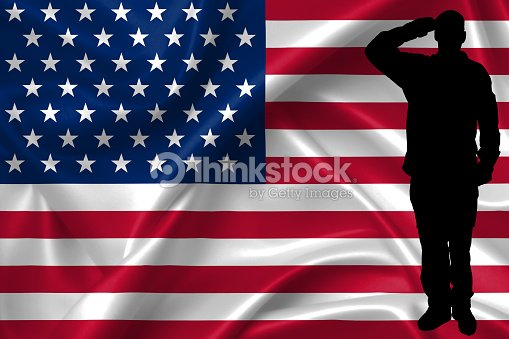 silhouette of american usa soldier saluting to usa flag