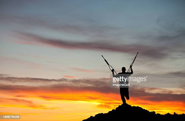 Silhouette of an Amputee With Crutches Raised