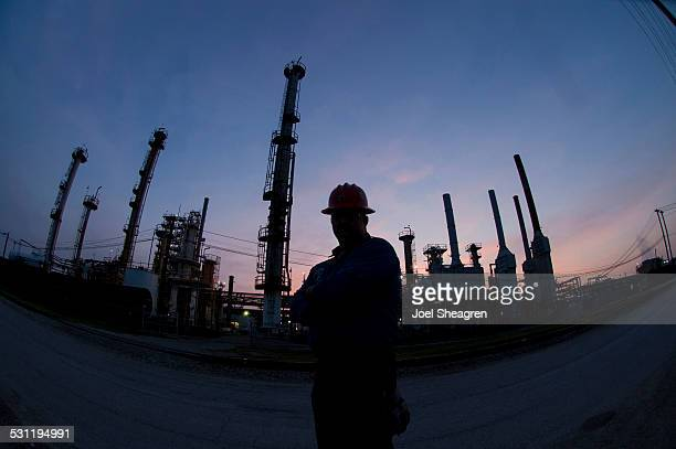 Silhouette of an oil worker in the evening