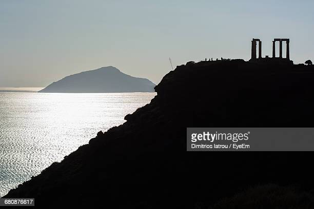 Silhouette Of Ancient Temple On Cliff
