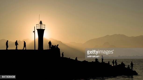 Silhouette Of Antalya Marina Lighthouse In Sunset