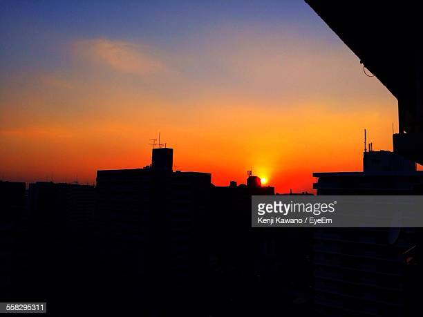 Silhouette Of Apartments At Sunset