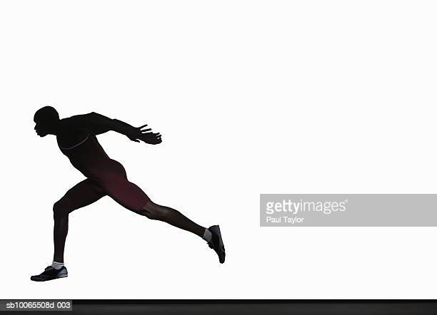 Silhouette of athlete running, side view