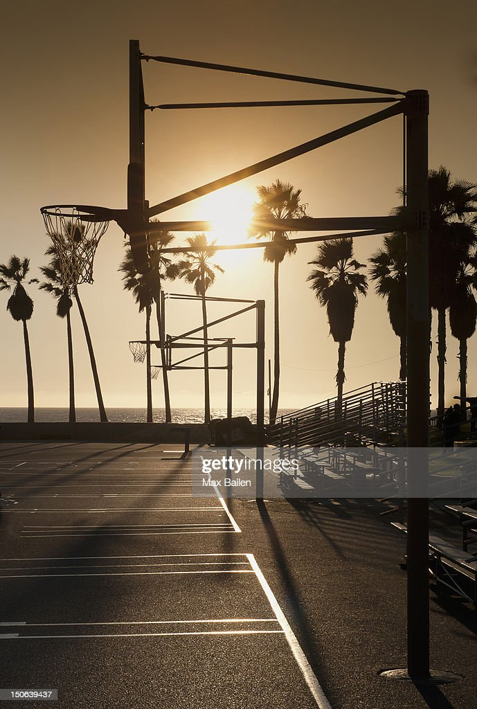 Silhouette of basketball hoop on court : Stock Photo
