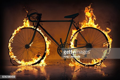 Silhouette of bicycle with flaming tires