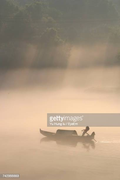 Silhouette Of Boat On Water