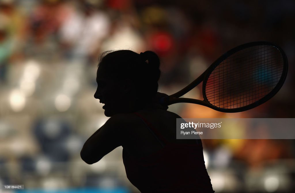 A silhouette of <a gi-track='captionPersonalityLinkClicked' href=/galleries/search?phrase=Bojana+Jovanovski&family=editorial&specificpeople=4836646 ng-click='$event.stopPropagation()'>Bojana Jovanovski</a> of Serbia is seen as she plays a backhand in her second round match against Vera Zvonareva of Russia during day four of the 2011 Australian Open at Melbourne Park on January 20, 2011 in Melbourne, Australia.