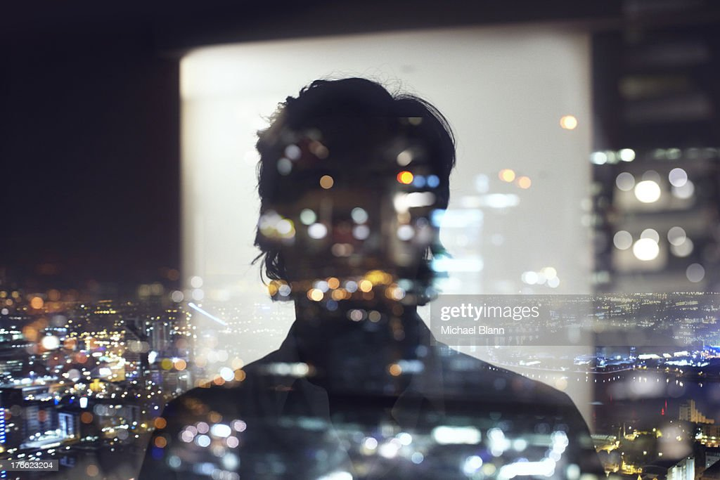 silhouette of business man against city : Stock Photo