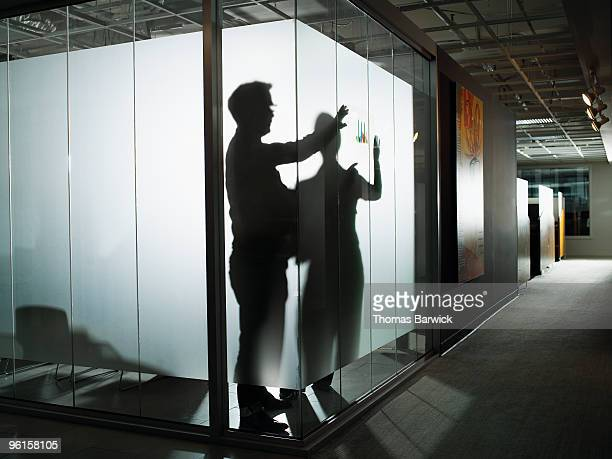Silhouette of businessman and woman