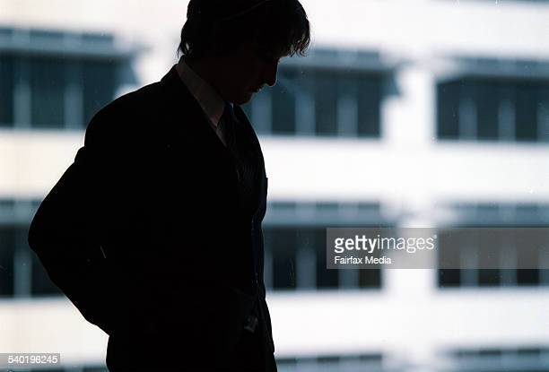 Silhouette of businessman in office with building