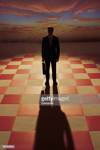 Silhouette of businessman on chessboard