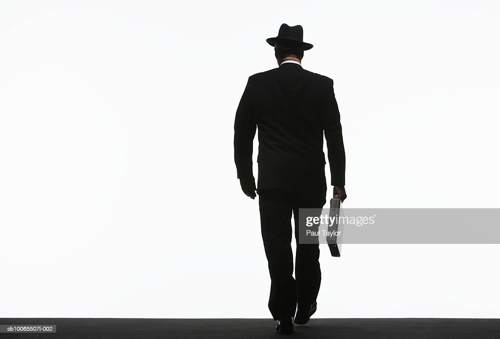 Silhouette Of Businessman Walking With Briefcase Rear View ...